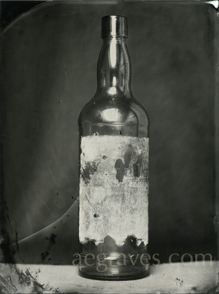 wet collodion image of a dark bottle with glue and paper remnants, Summer 2012, by A.E. Graves