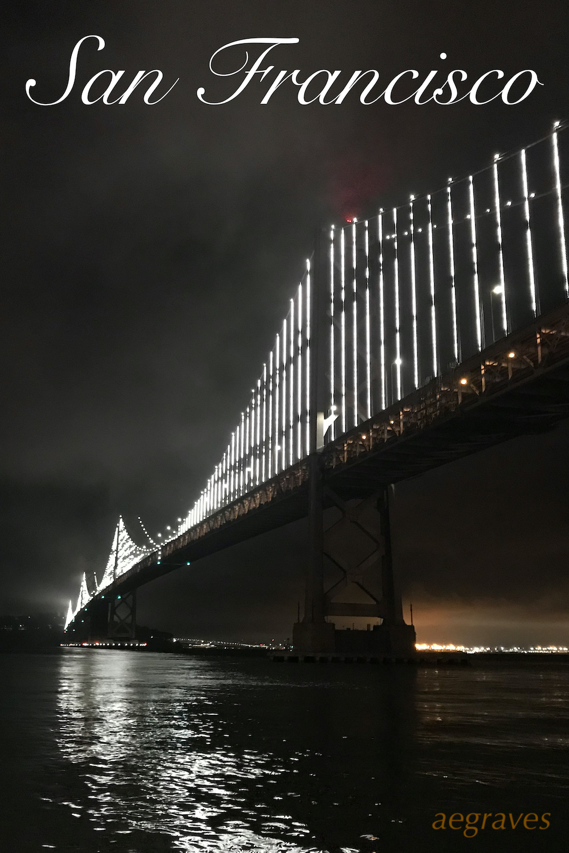 San Francisco Bay Bridge by Night in light fog